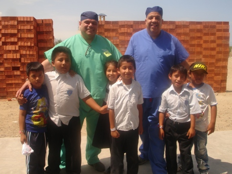 Juan and me with Kids outside of clinic